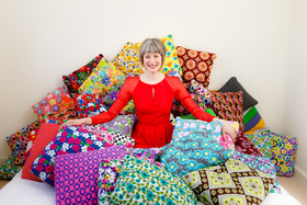Founder Fritha Vincent in a bed of Secret Pillows